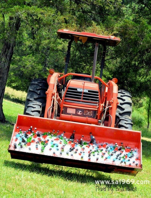 Front loader used to ice down drinks for rustic farm wedding