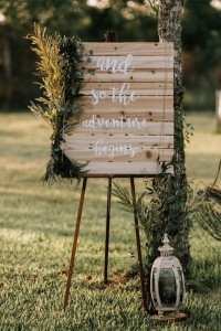 bohemian wedding sign ideas with greenery decorations
