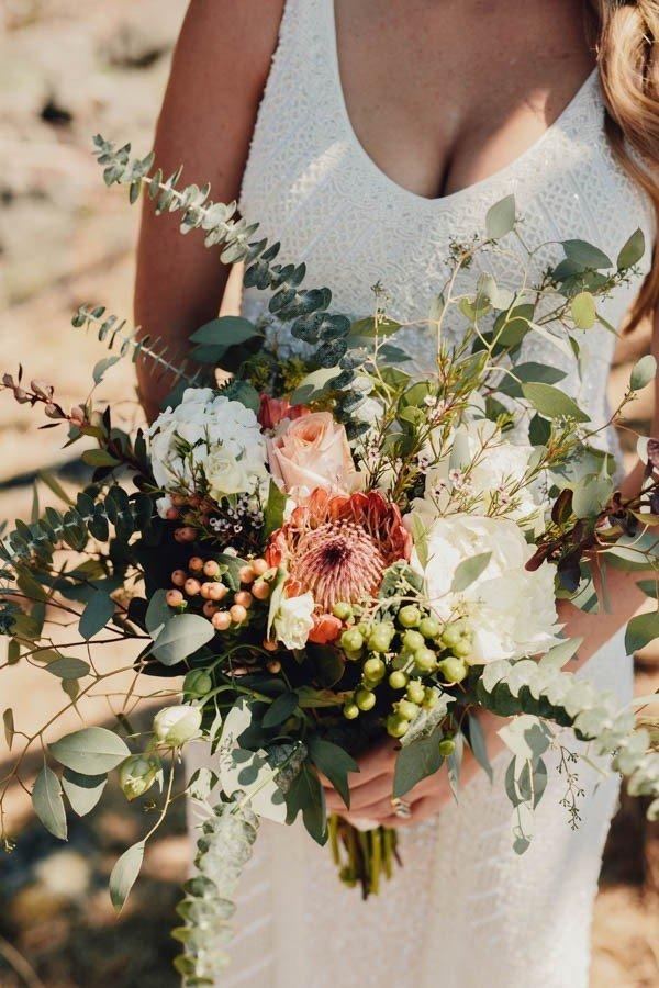 boho chic wedding bouquet with overflowing foliage