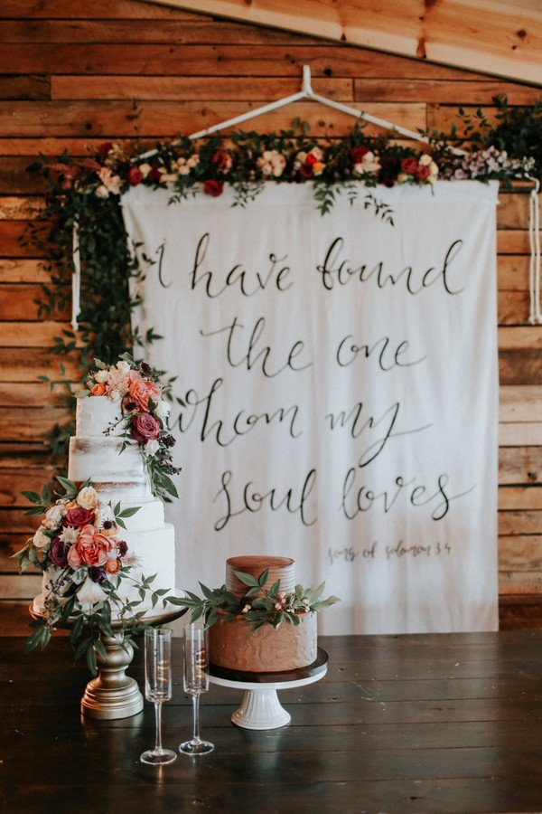 wedding backdrop ideas with floral and Bible verse