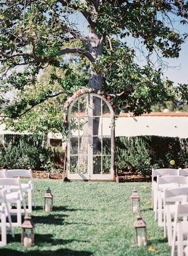 Wedding arch ideas used old door decorated with floral garland