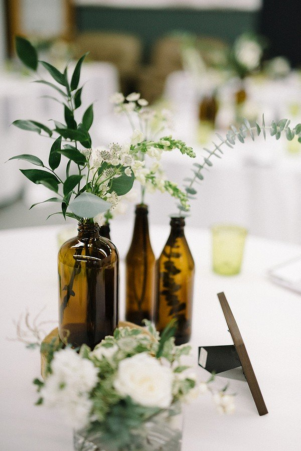 chic amber bottle wedding centerpieces