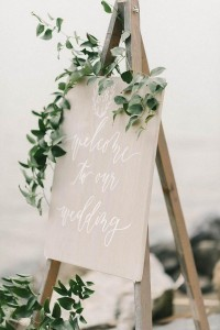 chic greenery wedding sign with white calligraphy