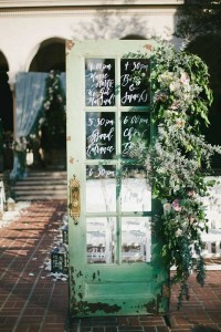 chic old door wedding sign ideas with greenery