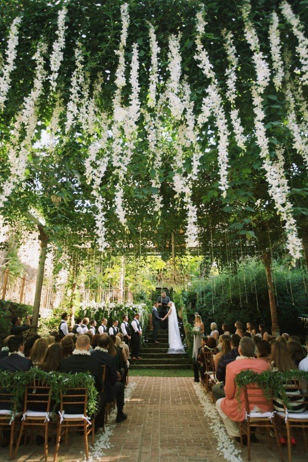 gorgeous greenery and flowers hung from the ceiling wedding ceremony