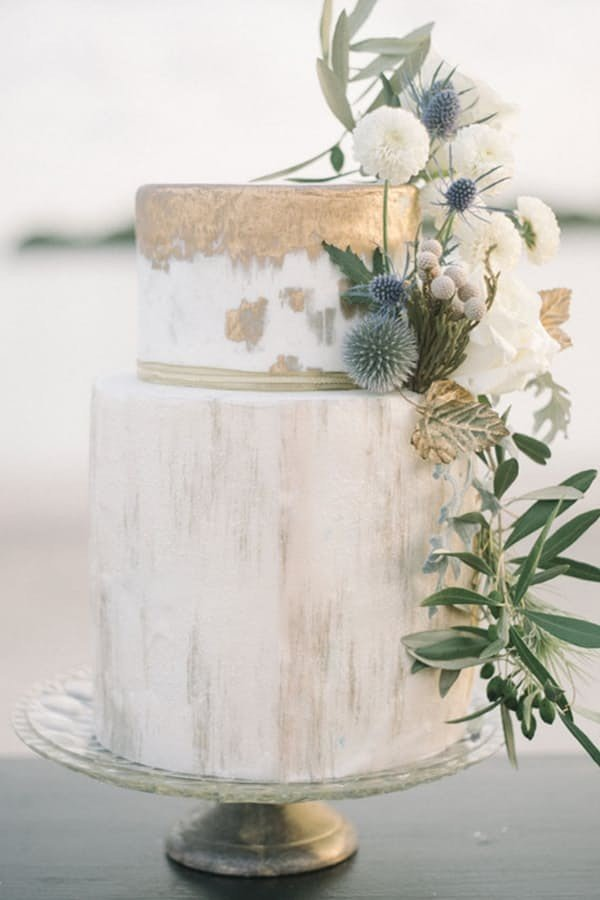 metallic gold wedding cake with greenery