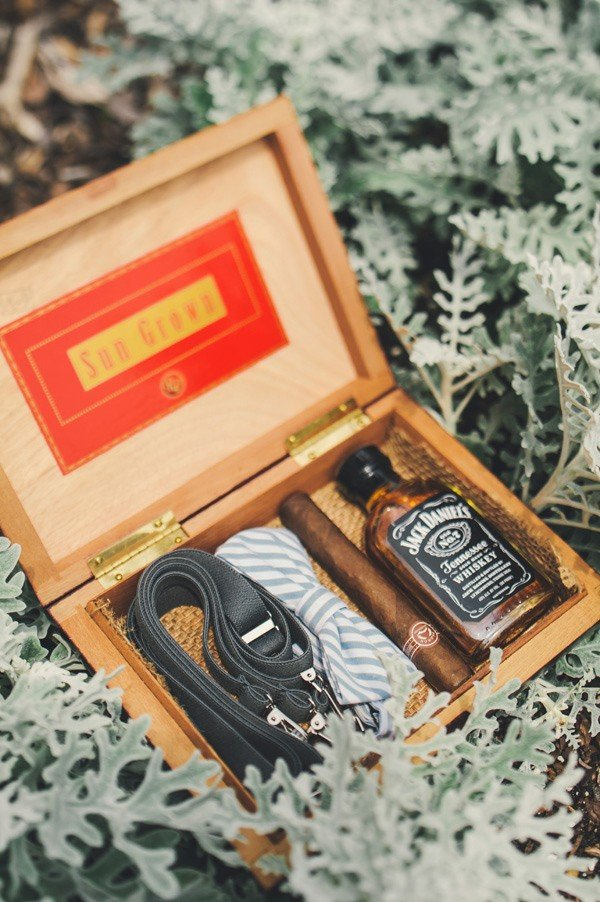 vintage cigar box filled with small bottle of liquor groomsmen gift ideas