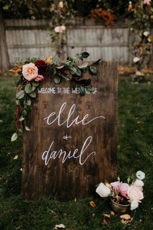 vintage wooden wedding sign with greenery