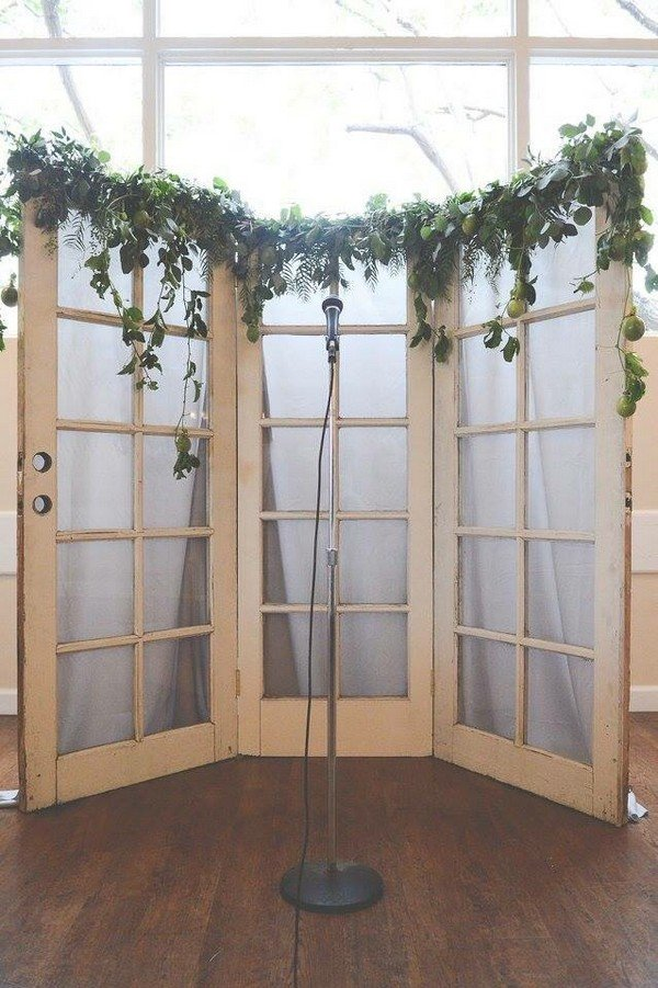 wedding backdrop ideas with greenery and vintage old door