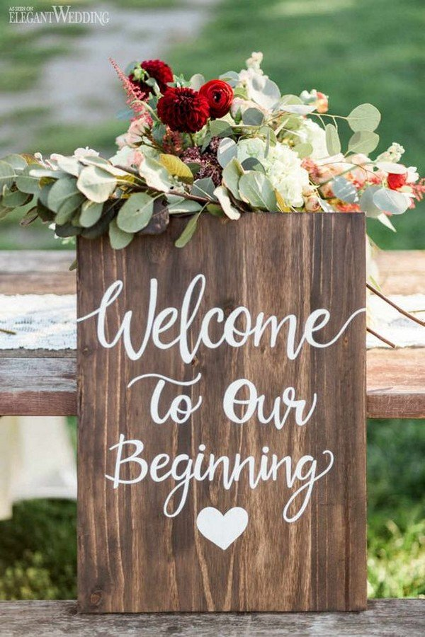 wooden wedding sign with floral and greenery