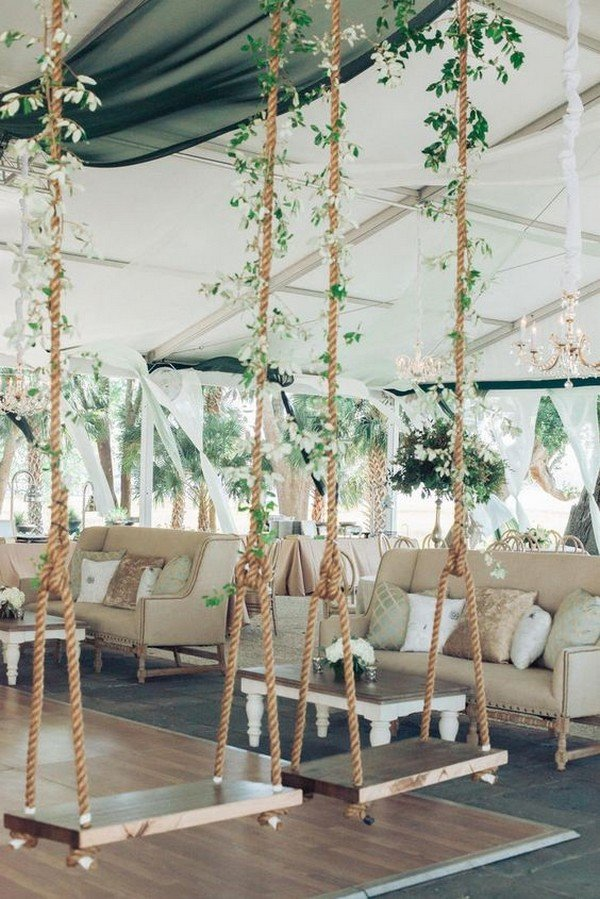 Whimsical wooden swings in wedding reception area
