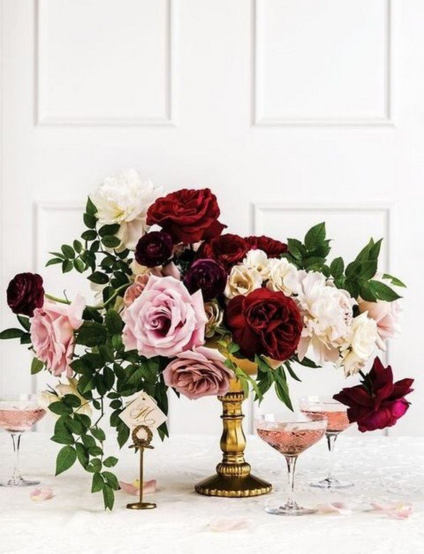 blush and burgundy wedding centerpiece with a touch of gold