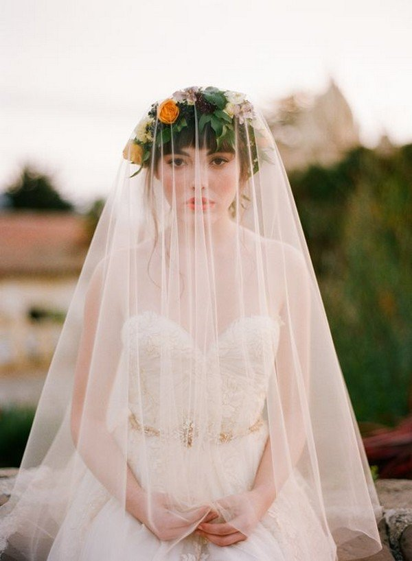 boho bridal look with flower crown and veil