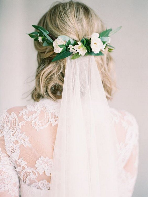 medium wedding hairstyle with flower crown and veil