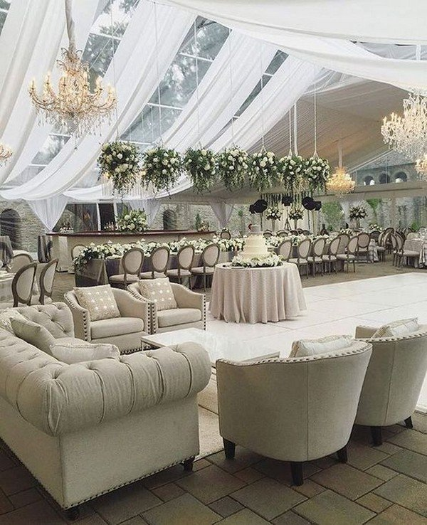neutral-hued and greenery-filled tented wedding lounge area ideas