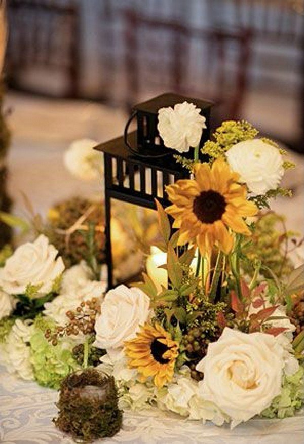 rustic wedding tablescape with sunflower centerpieces