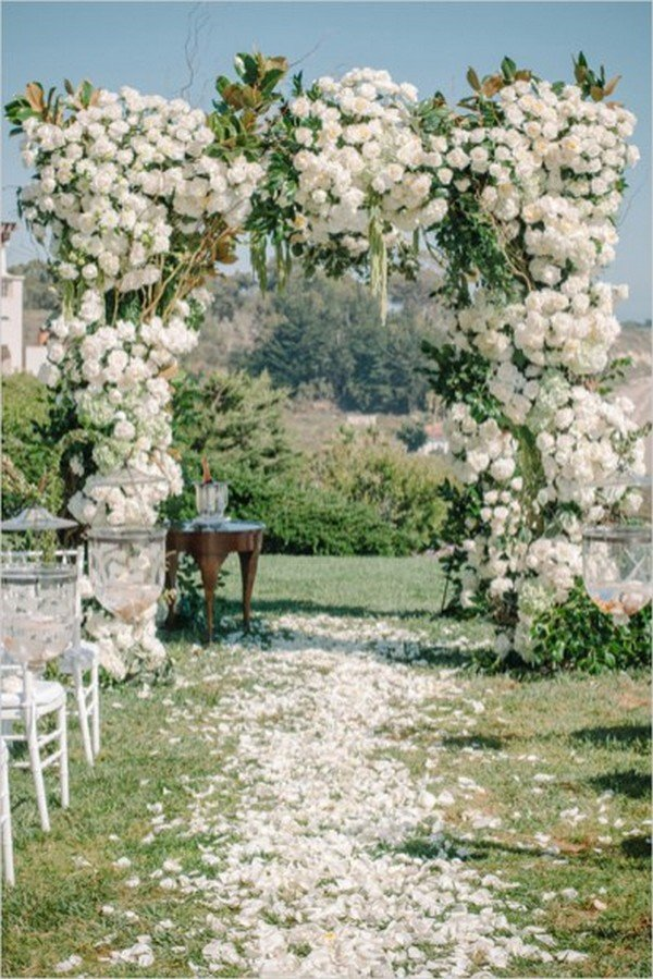 whimsical white and green wedding arch decorations