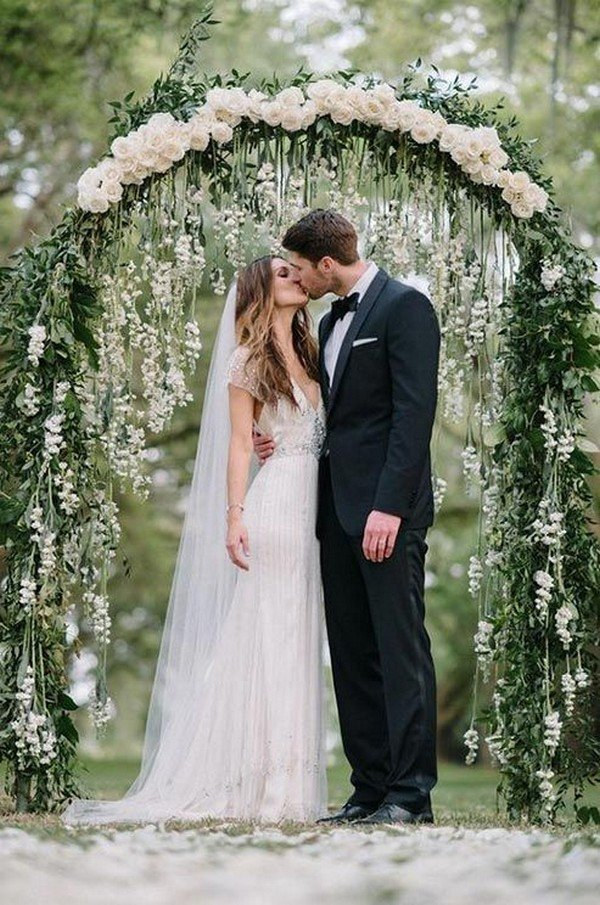 white and green garden wedding arch