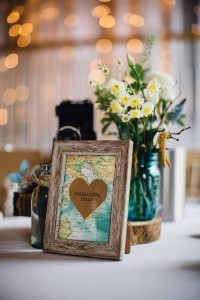 vintage map travel themed wedding centerpiece