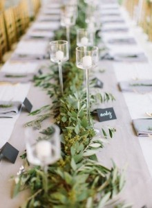 elegant greenery wedding centerpiece with candles
