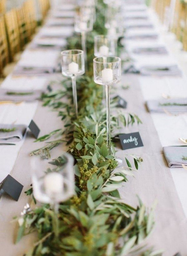 elegant greenery wedding centerpiece with candles