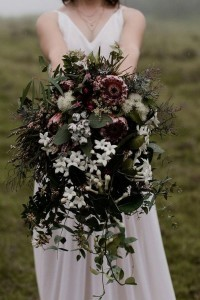 moody native purple and white wedding bouquet