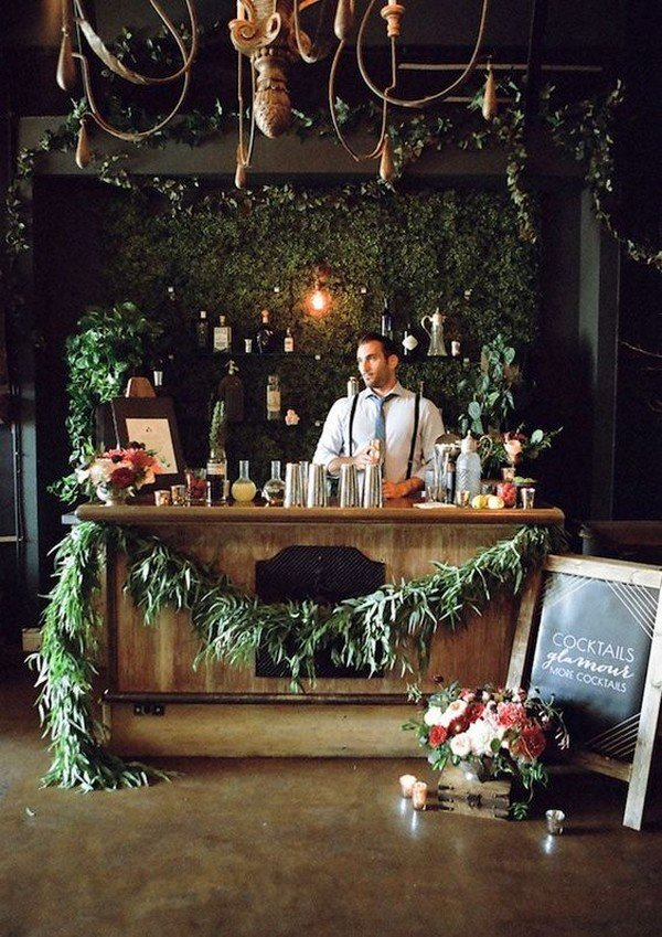 wedding reception bar with floral and foliage decorations