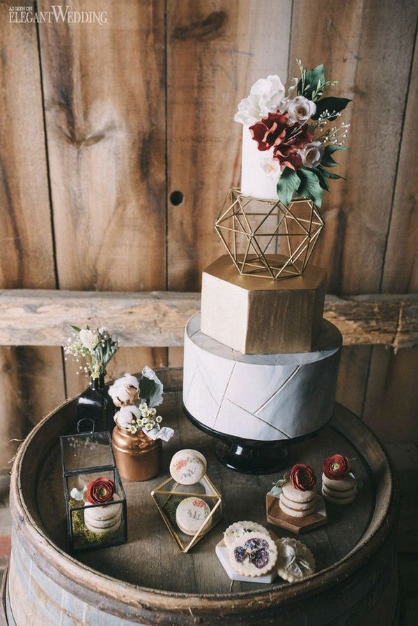 boho themed geometric wedding cake with gold details