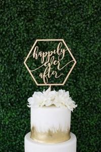 gold metallic wedding cake with geometric laser cut topper