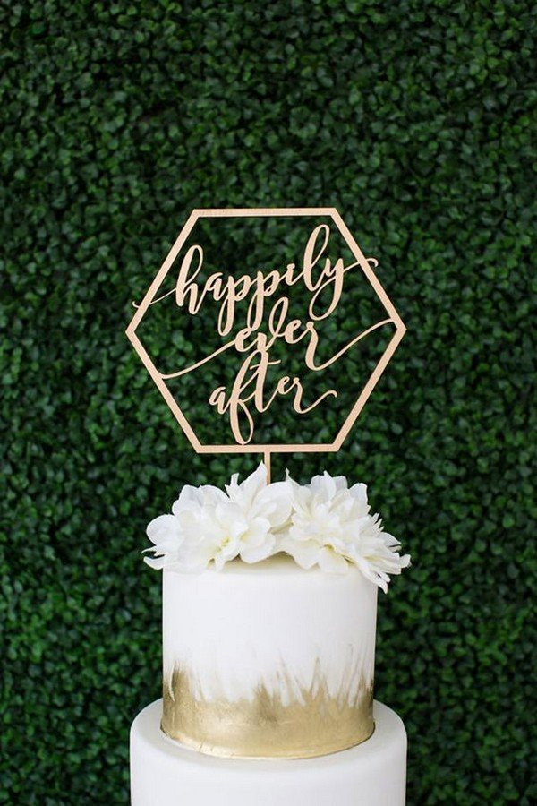 gold metallic wedding cake with geometric laser cut topper