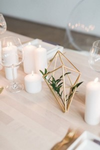 simple chic wedding centerpiece with candles and geometric