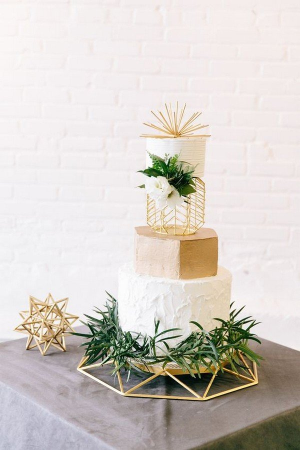 white and gold geometric wedding cake with greenery