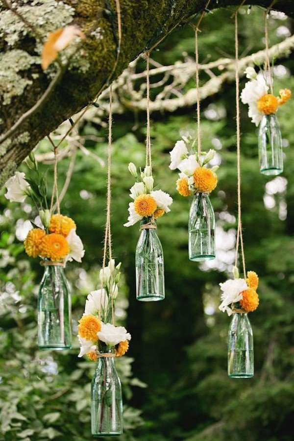 hanging wedding decorations with bottles and floral