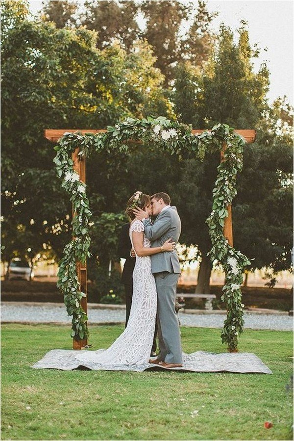 wood and greenery boho chic wedding arch