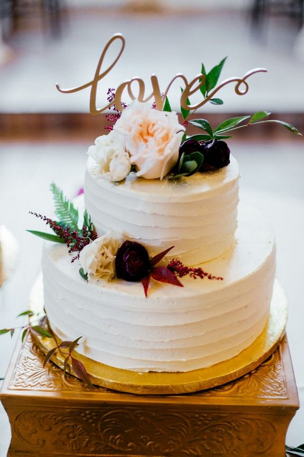 burgundy and gold fall wedding cake with monogram topper