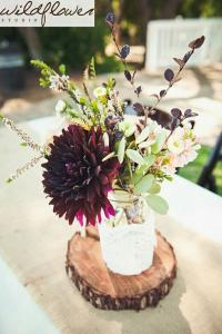burgundy and greenery rustic outdoor fall wedding centerpiece