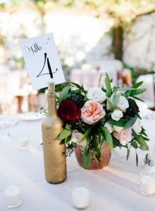 burgundy blush and greenery wedding centerpiece