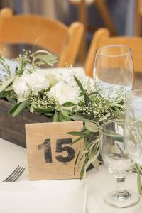chic rustic wedding centerpiece with olive branch