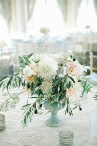 chic wedding centerpiece with olive branch
