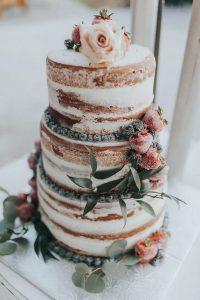 elegant naked fall wedding cake with fruits and flowers