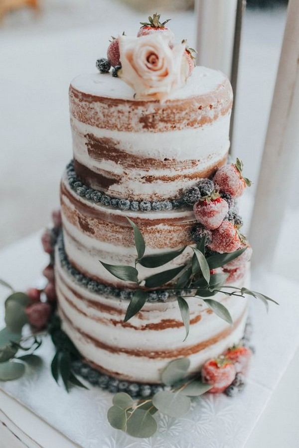 elegant naked fall wedding cake with fruits and flowers