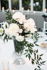 elegant wedding centerpiece with olive branch