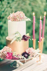 metallic gold fall wedding cake with flowers