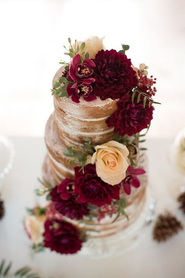naked wedding cake with deep red flowers for fall