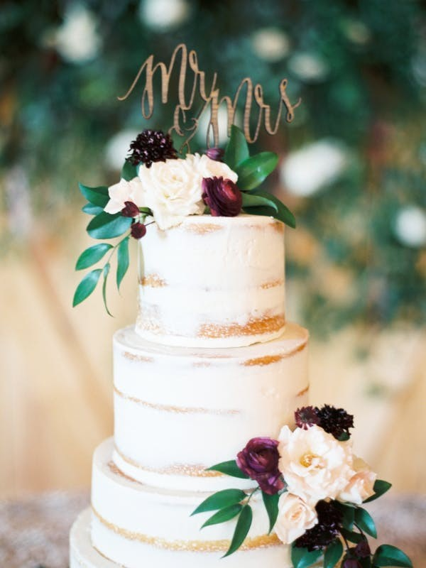 plum and greenery fall wedding cake