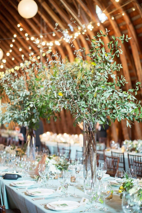 rustic barn tall wedding centerpieces with olive branch