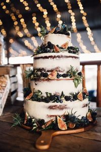 semi naked wedding cake with fig decor for fall weddings