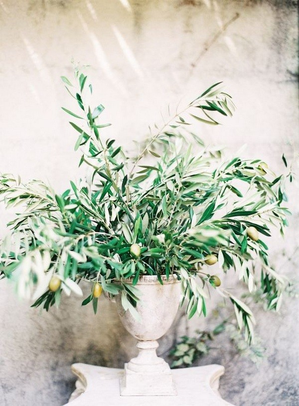 vintage wedding centerpiece with olive branch