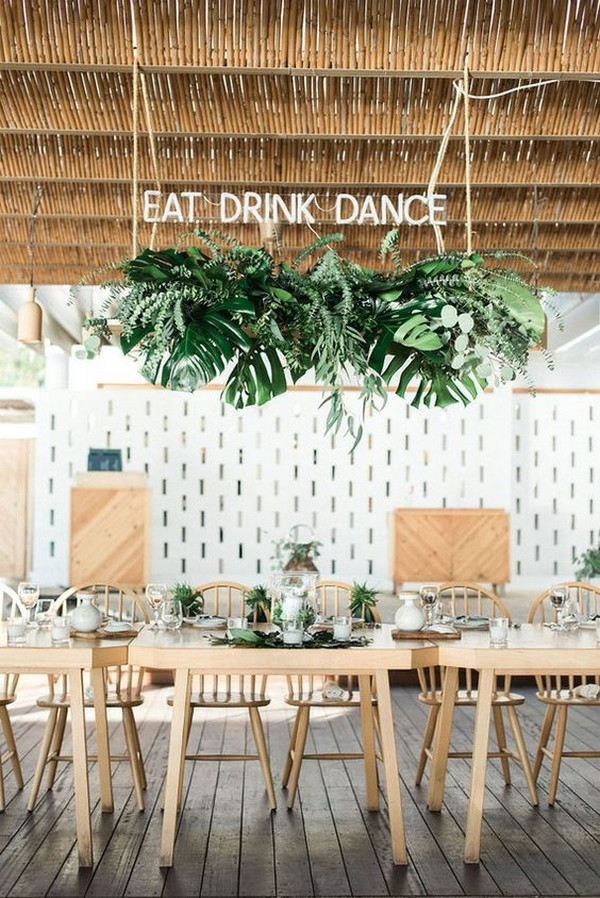 Mediterranean island wedding reception with hanging greenery