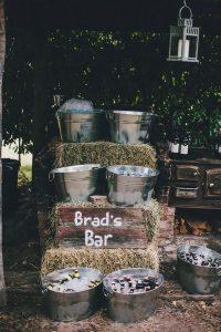 backyard hay bale wedding bar station ideas